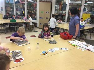 Williams helps kindergarteners with art lesson
