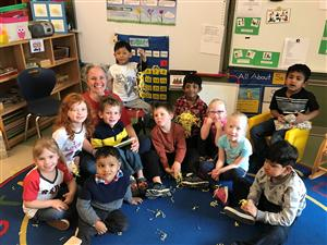 Joy Nichols sits with preschool class
